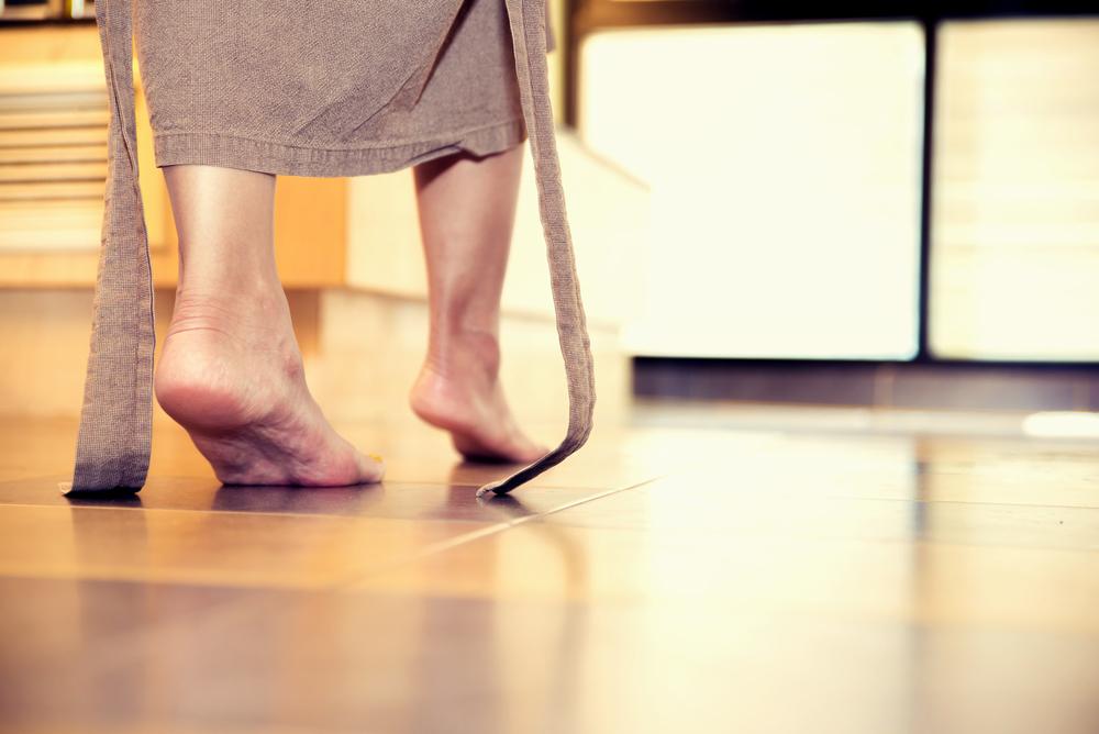 feet on tile floor